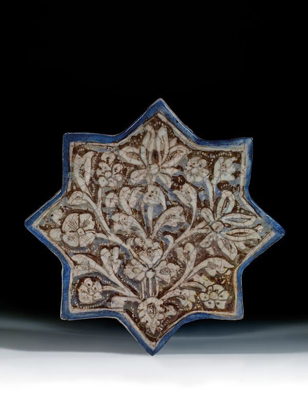 A 13th/14th century Ilkhanid Iranian ceramic star shaped tile