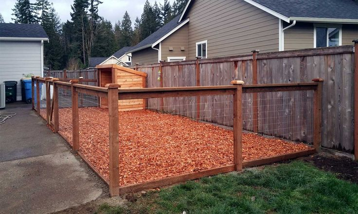 AFTER: The finished dog kennel includes a steel fence with pressure-treated wood frame, sliverless cedar chips and a manger-style shed.
