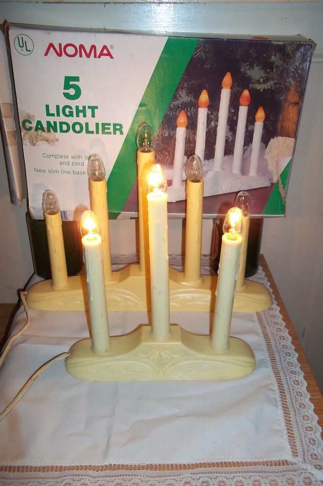 Got lots of windows? We have several sets of these! Contact me  Set 3 and 5 Tiered Noma Candleabra Candolier Candle Christmas Lights