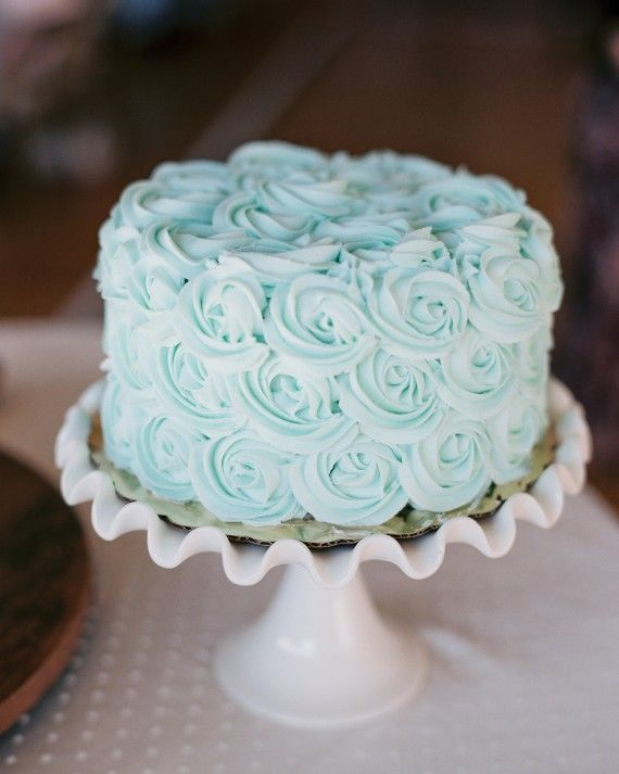 "For her ""something blue,"" this bride chose a single-tier mint-chocolate creation with pale blue rose-swirled icing courtesy of Buttercup Bakery."