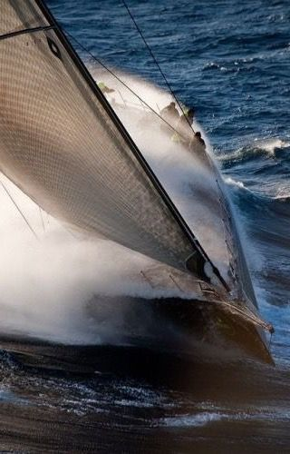 fantastic shot of a yacht racing upwind