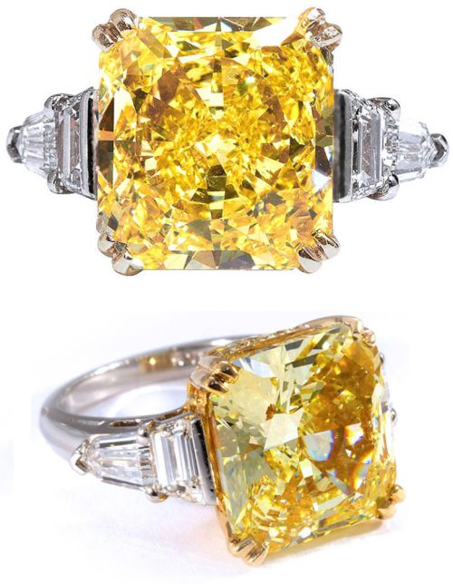Oscar Heyman Important Fancy Intense Yellow Diamond Ring. Extraordinary 10.11 carat Fancy Intense Yellow radiant cut diamond of VS1 clarity in platinum and 18k gold ring by Oscar Heyman. White diamond side tapered baguettes and shields.