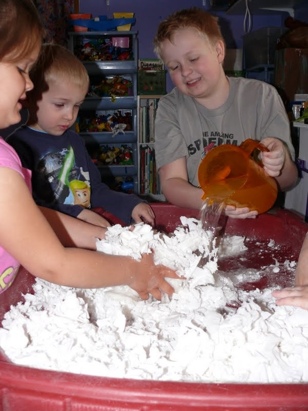 Making 'clean mud' using torn up paper and warm water.