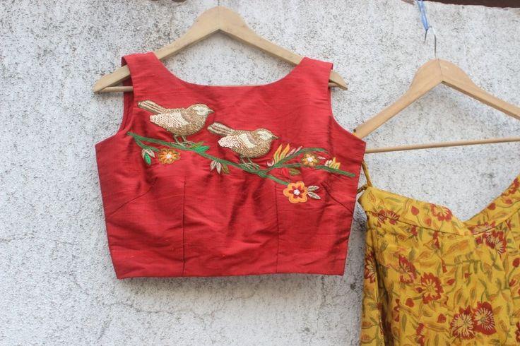 Embroidered Sparrow crop top from PRITISAHNI.For more information write to info@pritisahni.com Priti Sahni lehenga 04 April 2017