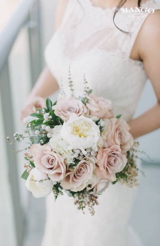 Featured Photographer: Mango Studios || Elegant Neutral Toned Wedding Bouquet Featuring: White Peonies, Champagne Roses, Silver Brunia, Andromeda Buds + Additional Coordinating Florals & Foliage
