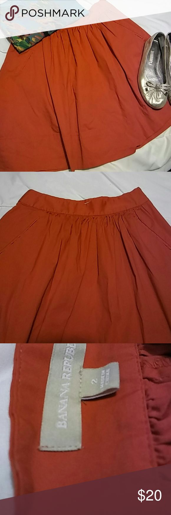 Banana Republic Red Zip Up Skirt Excellent condition Banana Republic skirt with pockets. Size 2. 97% cotton, 3% spandex. Flats and shirt not included, check other listings for those. Banana Republic Skirts