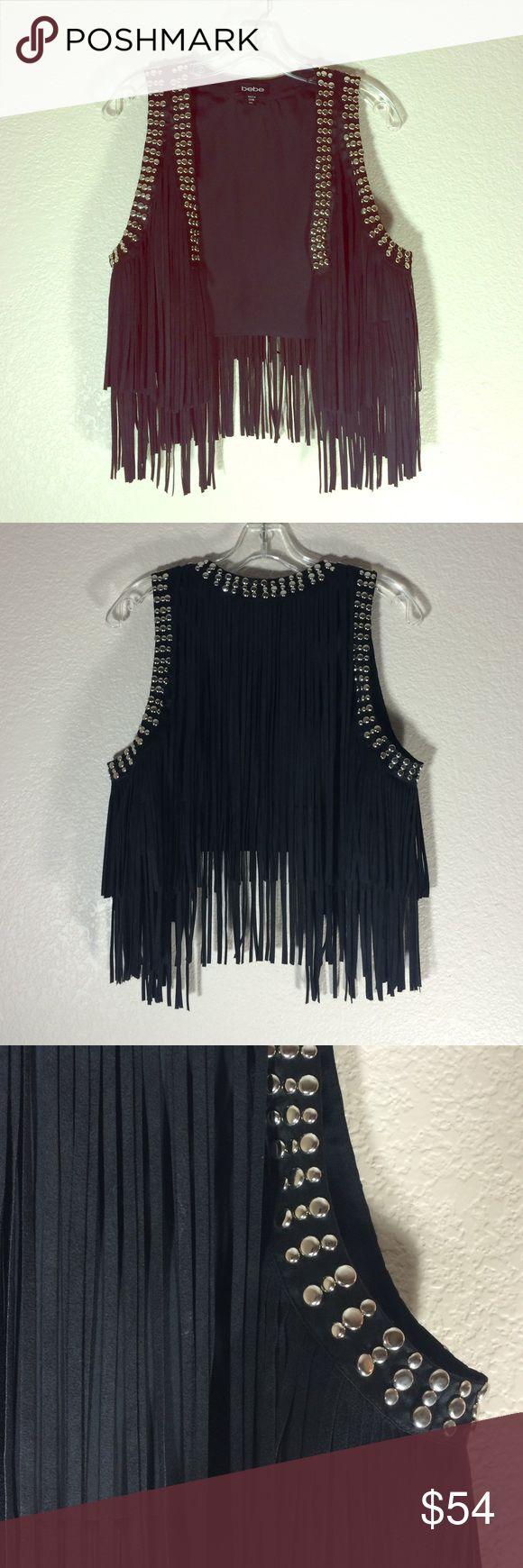 Black Fringe Vest with Silver Studs Black fringe vest with silver studs. bebe Jackets & Coats Vests
