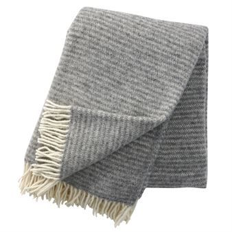 The stylish Ralph wool throw comes from Klippans Yllefabrik and has a classic pattern with stripes. The throws are made in organic lamb wool and are good for the environment. They also keep you warm on cold winter days or summer nights and become a nice and timeless detail at the couch. Combine with other blankets from Klippans Yllefabrik!