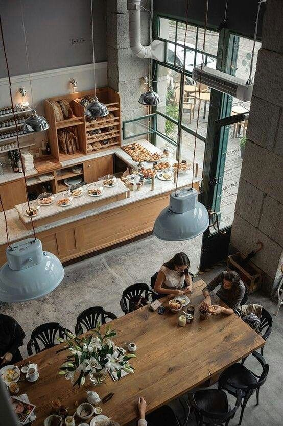 Would like to have a spacious livingroom with a big table in it, like this cafe interior