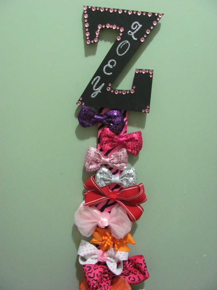 Hair Barrete holder: Ribbon, hot glue, stick on jewels, letter stickers, wooden letter, paint. 1. Paint letter let dry and then decorate hot glue ribbon to letter