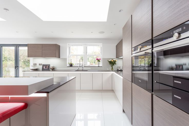 Handless German Nolte Glasstec Kitchen in Sahara and contrasting veneer units with Island.