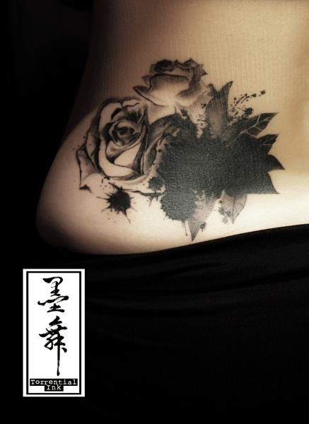 cover-up.    used some ink splatters and leaves to cover the original tattoo, with high contrast shaded roses.    and this is a healed one.
