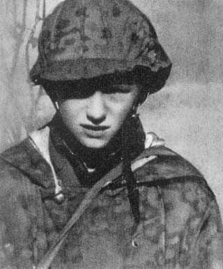Warsaw Uprising: Young polish courier from Starówka district wearing German Wintertarnwendejäcke M42 uniform.