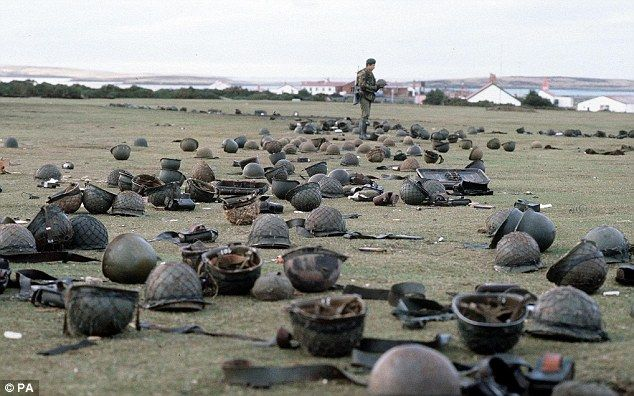 The Falklands War - Steel helmets left by Argentine armed forces who surrendered at Goose Green to British troops