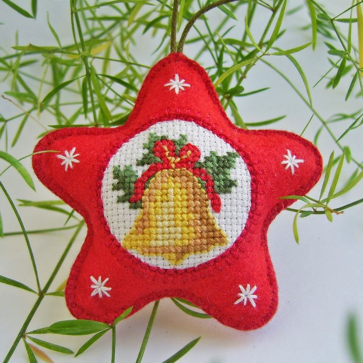 Christmas Decorations - great inspiration for making a felt ornament with a small cross stitched piece.