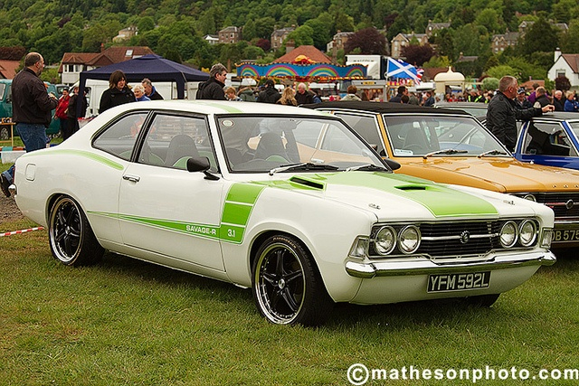 White cortina with lime green graphics.