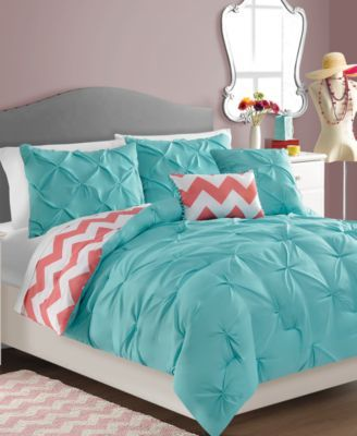 Sophia Reversible 5-Piece Comforter Set $63.99 Brighten the look of your bedroom with this lively and whimsical comforter set, featuring a solid turquoise ground with gathering that reverses to a bold white and coral chevron print. Matching shams and decorative pillows accent the set perfectly.