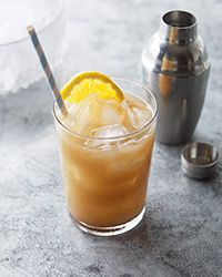 Tamarind Whiskey Sour 1 1/2 ounces bourbon 1 ounce fresh lime juice 1 tablespoon tamarind paste mixed with 1 tablespoon hot water and cooled 1/2 ounce Rich Simple Syrup 1 orange slice and 1 jarred sour cherry (optional), for garnish