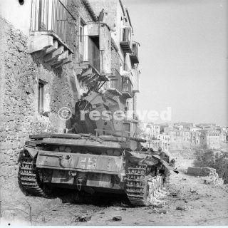 17 August 1943 A German Mk III tank knocked out during the fierce street fighting in sicilia Centuripe enna_sicilia word war