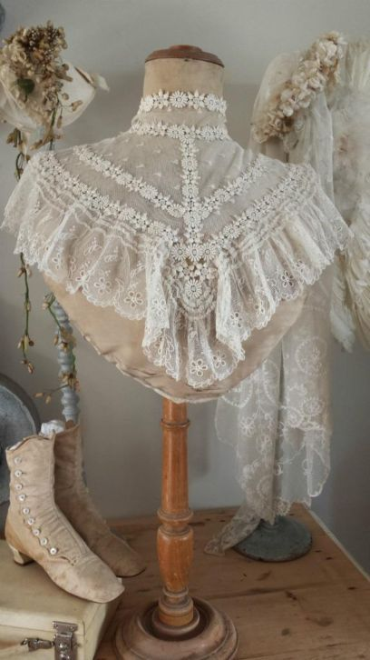 Lace. I have something very similar to the capelet. I love it, never enough places to wear it.