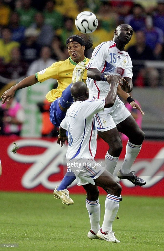 Ronaldinho (L) of Brazil competes for the ball with Lilian Thuram (R) of France during the FIFA World Cup Germany 2006 Quarter-final match between Brazil and France at the Stadium Frankfurt on July 1, 2006 in Frankfurt, Germany.