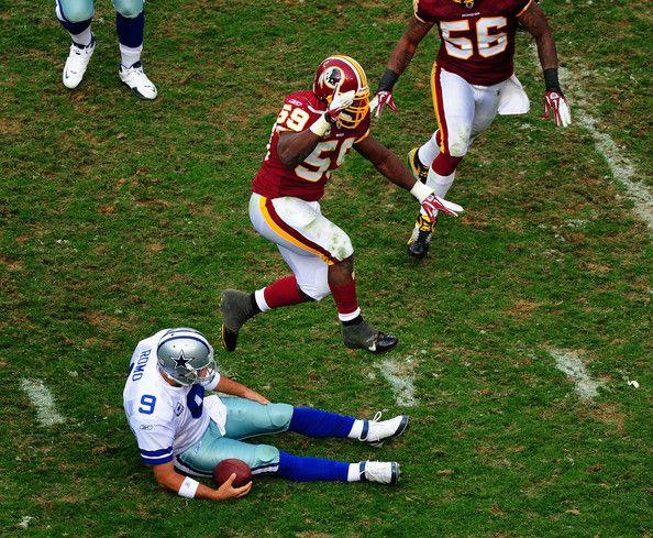Tony Romo Photos Photos - London Fletcher #59 of the Washington Redskins celebrates after a sack against Tony Romo #9 of the Dallas Cowboys at FedEx Field on November 20, 2011 in Landover, Maryland. - Dallas Cowboys v Washington Redskins