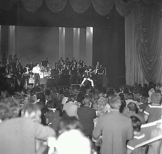 Tom Jones invited Elvis onstage at Las Vegas. Imagine being in that audience, it would have been hard to settle the audience after kicking Elvis off. 3 September, 1974.