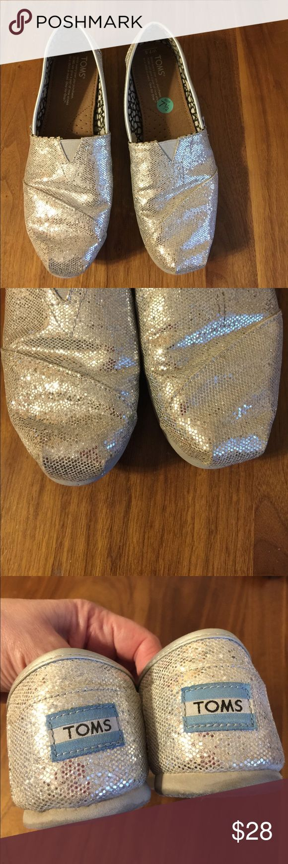 Glitter TOMS Silver glitter TOMS slip on shoes. Great condition. TOMS Shoes