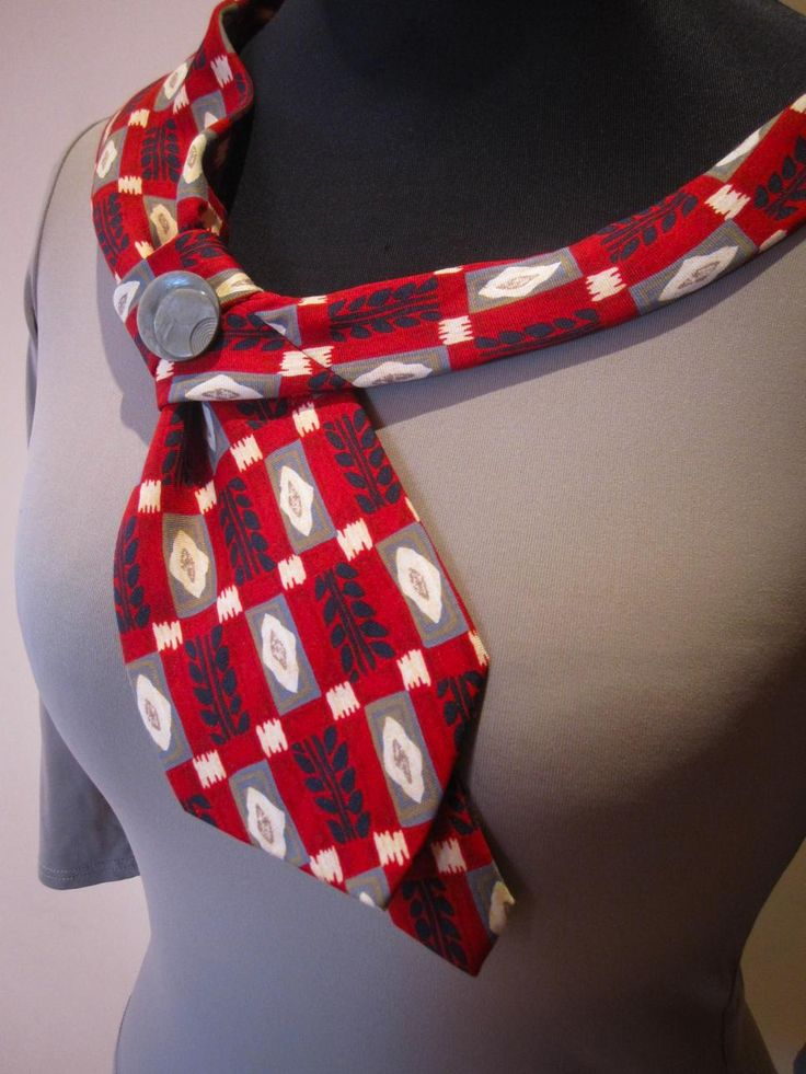 """Who says neckties are just for guys? """"I've always loved to wear neckties, just like a man wears his,"""" says Erin Stevens, owner of the Etsy shop Garage Couture Clothes, which specializes in upcycled women's clothing. """"One day I started draping ties on women's camisoles and thought, wow, this is really cute. If you can sew on a button, you can do this project."""" This tie is hand-stitched in place and anchored with a button; you may have to add extra stitches here and there to get the tie to…"""