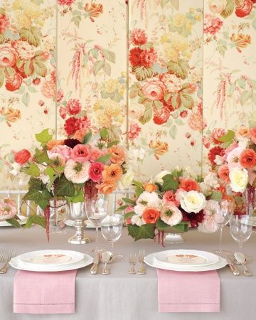 "Romantic Centerpieces Inspired by Chintz    This isn't your grandmother's floral: Cowtan & Tout's ""Le Rosier"" fabric takes a classic motif from sort-of-prim to oh, so pretty. With the help of a staple gun, the material covers an Oriental Furniture room divider and plays muse to the garden roses, ivy, dahlias, and trailing amaranthus that fill silver vessels on the table."