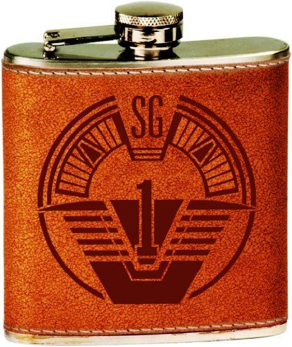 SG-1 Patch Logo Engraved Stainless Steel 6 oz. Flask - Leather Cover by Spiffy Custom Engraved Flasks. $16.95. Stainless Steel 6 oz. Flask with Leather Cover features a Dark Brown Laser Engraved Design. Handsome, Classic Style Flask is constructed on Quality Food Grade Stainless Steel. Captive Screw Down Cap is tight-fastening to prevent spillage of your favorite beverage. Swing Hinge anchors lid so it remains securely attached to flask -  No chance of misplacing the top dur...