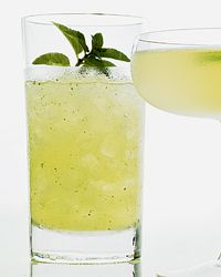 Mojito!  In a cocktail shaker, muddle the mint leaves. Add ice and the rum, lime juice and Simple Syrup and shake well. Strain into an ice-filled collins glass, stir in the club soda and garnish with the mint sprig.