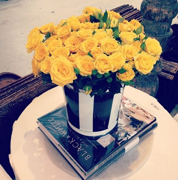 Parisian black and white glamour! Love that pop of yellow rose colour! #love #magnoliainteriors #yellow #blackandwhite #beautifulbooks