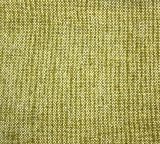 drift plain fabric a plain woven fabric in a yellowy moss green suitable for contract and