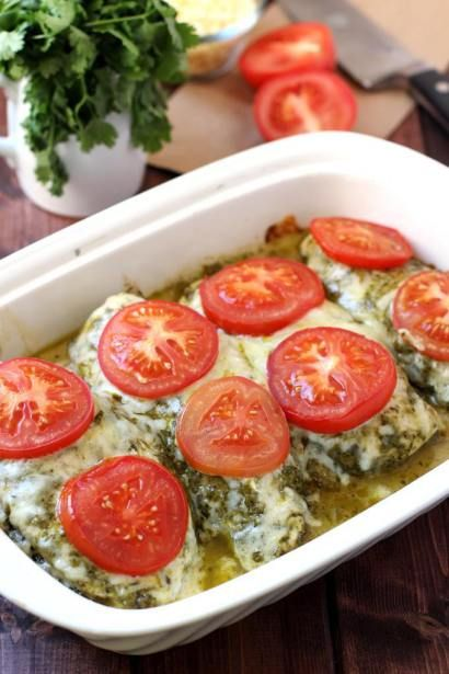 This Chicken Pesto Bake showcases whole-food ingredients at their finest. Chicken breasts rubbed with basil-pesto and topped with melty mozzarella and roasted tomatoes comes together in 5 minutes or less and is bursting with flavor. Simple enough for a last minute family super, but impressive to serve guests!
