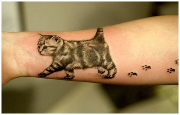 Paw Prints And Cat Tattoo On Right Forearm