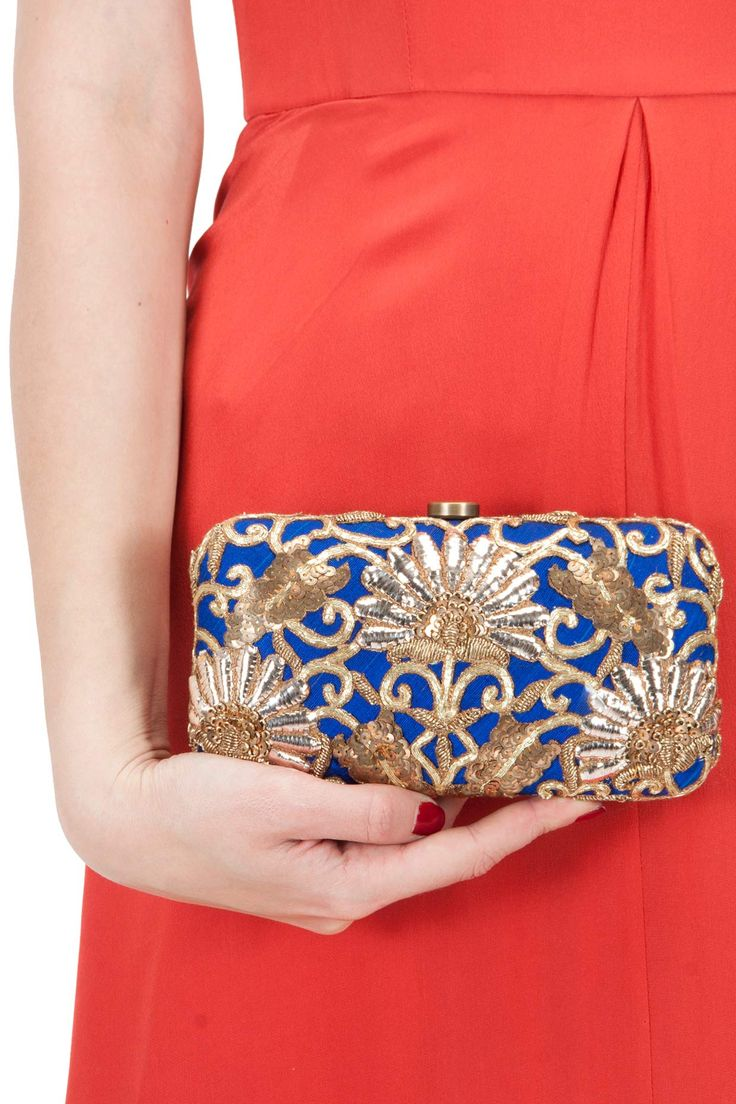 Blue prosperity clutch available only at Pernia's Pop-Up Shop.