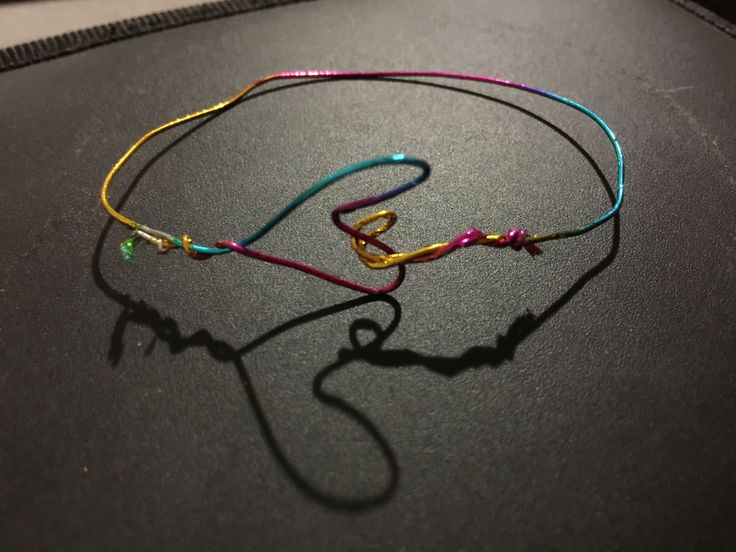 Experimentation using metal wire to create a bracelet
