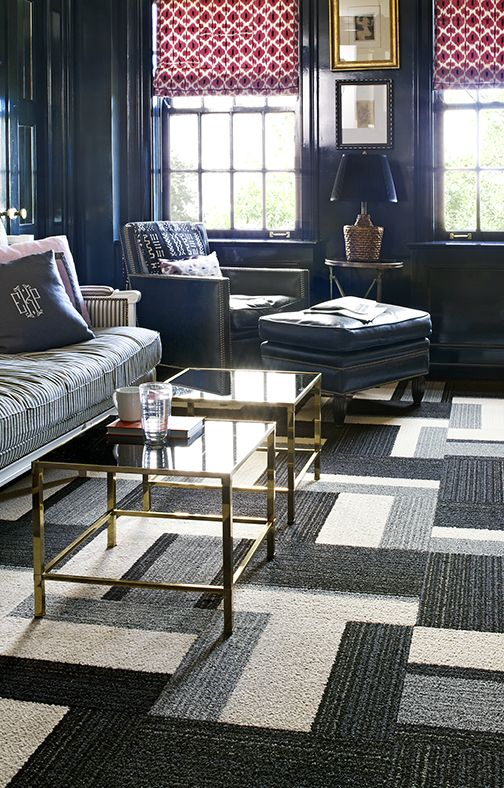 This black, white, and grey square carpet adds dimension to the room.
