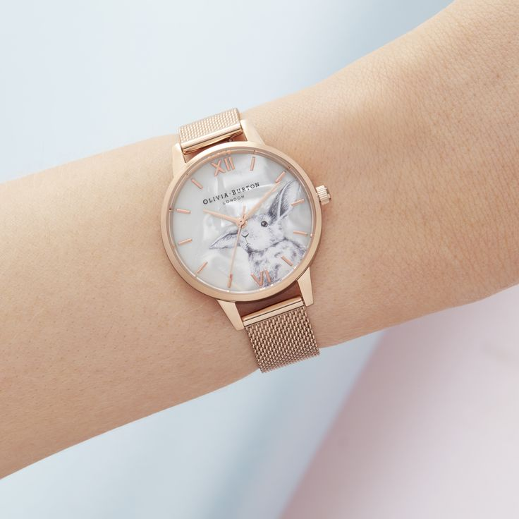 OB16WL85   Olivia Burton Winter Wonderland  Escape to a winter wonderland with this adorable, hand-illustrated design. Comprising a shimmering faux Mother of Pearl 30mm dial, its natural flecks catch the light like falling snowflakes. Featuring our latest furry friend – every little detail hand-designed by our London-based designers – we've finished this style with complementing Rose Gold markers and a matching mesh strap.
