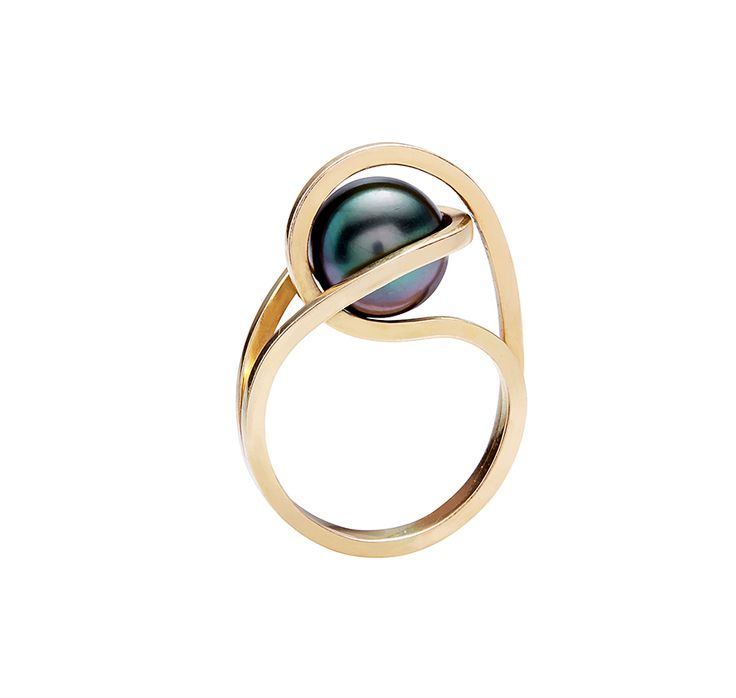 """Gurmit's """"Concubines"""" ring inspired by the yoni symbol in 18 carat gold and tahitian pearl. White gold, black pearl, I'd sell organs for it! ;-)"""