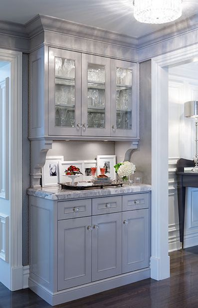 kitchens - gray glass-front cabinets corbels white carrara marble countertops butler's pantry  Gorgeous gray butler's pantry design with gray
