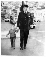 Police officer George Anderson with Michael Patrick Collins on Diamond Street at Bosworth circa 1955