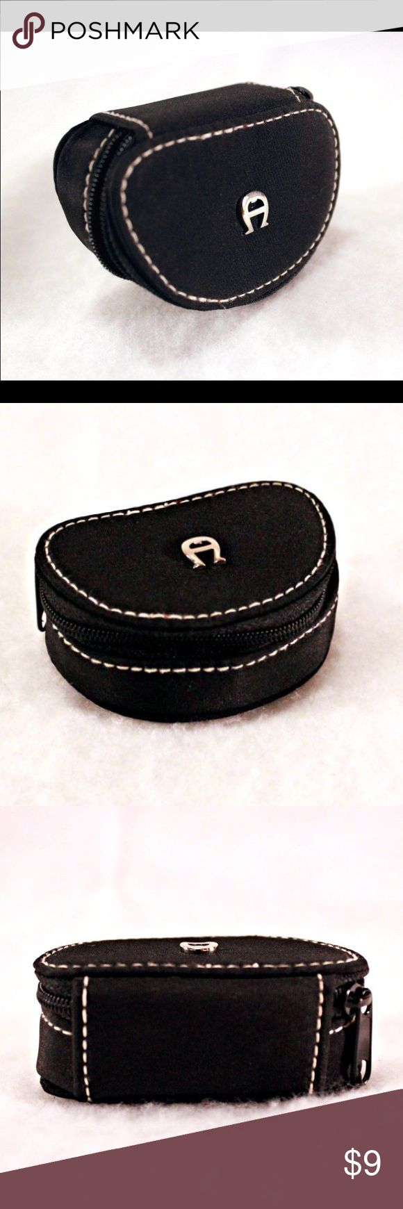 "ETIENNE AIGNER Travel Jewelry Case ETIENNE AIGNER Travel Jewelry Case. Black Satin with White Stitching. Zip Closure and Red Interior.  3x2x1 1/8"" Perfect for storing  Rings and Earrings While On the Go.   Orig. 18.00. Etienne Aigner Bags Travel Bags"