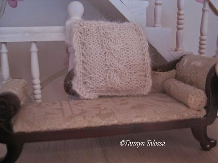 Miniature knit cable pillow.