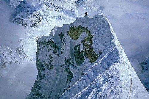 Mark Westman climbing along the knife-edge ridge section of Mt. Foraker - Click through to the Supertopo Photographer's Gallery! Images for, of and by climbers! #climbing #mountaineering