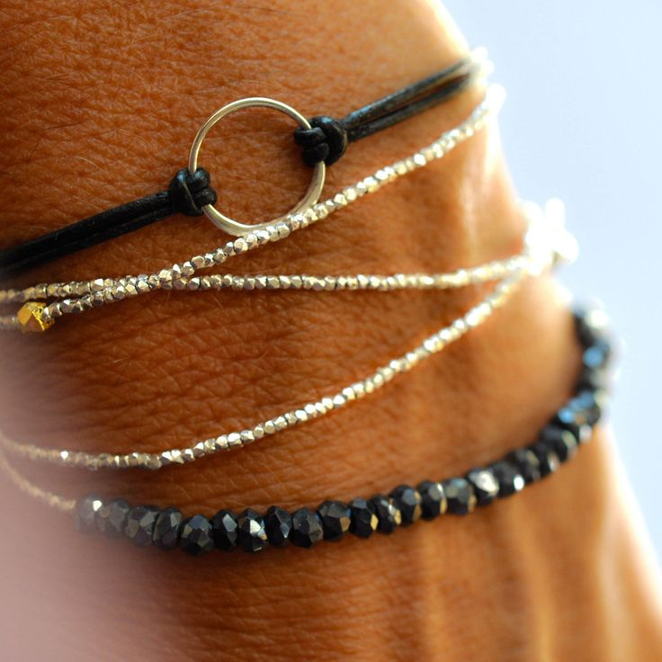 Love these delicate gold and silver bracelets by Vivien Frank!