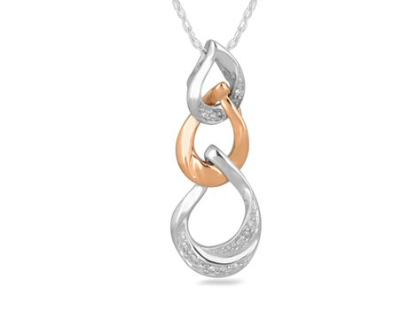 9ct rose gold & white gold #diamond drop pendant with thirteen brilliant cut #diamonds in grain settings.   #thomasjewellers