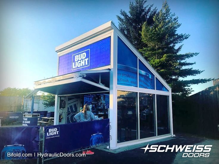 A total of 13 concession stands were outfitted with Schweiss lift-strap bifold doors to be used at amphitheaters in LA and all over the US. The custom-made doors were installed by Raven Productions to provide a convenient and secure point of sale for vendors like Budweiser and many others. Read more stories at: https://www.bifold.com/photo-of-the-day-barpod.php