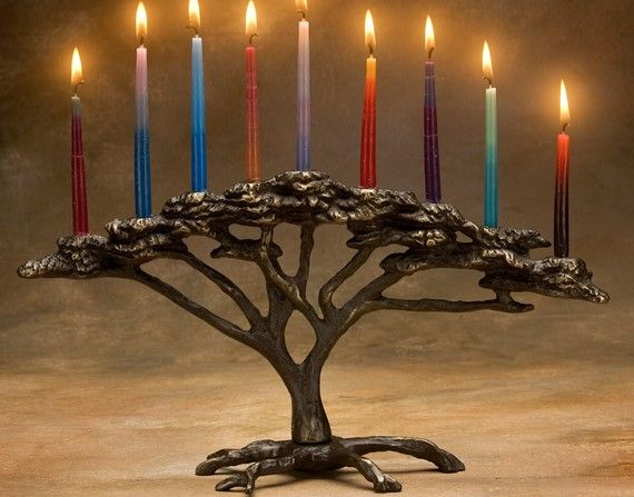 Nelles # 824: Sand-cast bronze Hanukkah menorah, inspired by the African Acacia tree. A charming addition to your holiday home, this candelabra will also